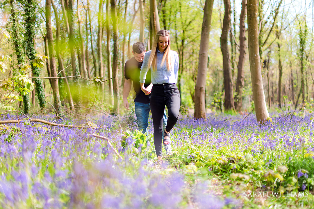 An engagement shoot in a bluebell wood